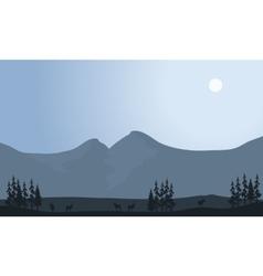 Silhouette of antelope in fields vector