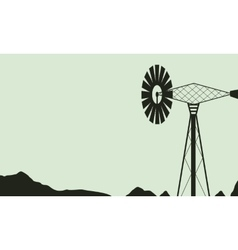 Silhouette of windmill on farm landscape vector image
