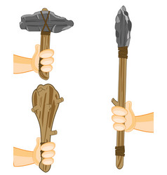 spear with axe and bat of the stone age in hand of vector image