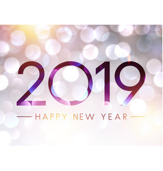 Blurred shiny happy new year 2019 background vector