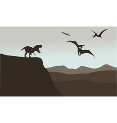 Silhouette of pterodactyl and tyrannosaurus vector image
