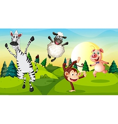 A hilltop with playful animals vector