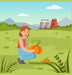 Farmer woman harvesting pumpkins in the field vector