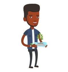 Man holding plant growing in plastic bottle vector
