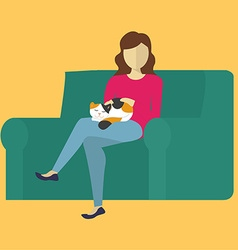 The woman on the couch petting a cat vector image