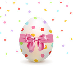 Painted easter egg and colorful confetti vector