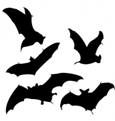 Flying bats silhouettes vector