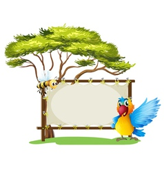 An empty framed banner with a parrot and a a bee vector image