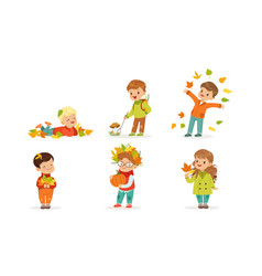 Cute boys and girls playing with autumn leaves vector