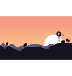 Silhouette of windmill and house landscape vector