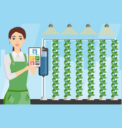 Woman farmer with digital tablet in greenhouse vector