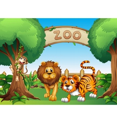 A monkey a lion and a tiger inside the wooden vector image
