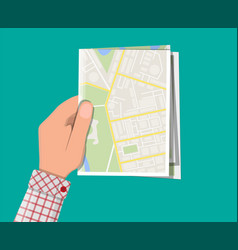 folded paper city map in hand vector image