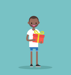 Young happy black man holding a bright gift box vector
