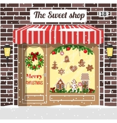 Christmas decorated and illuminated sweet shop vector image vector image