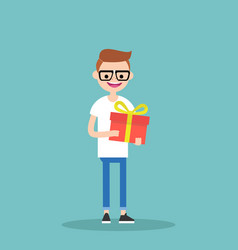 young happy nerd holding a bright gift box vector image
