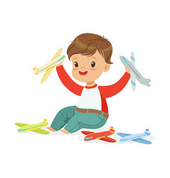 adorable happy little boy sitting on the floor vector image