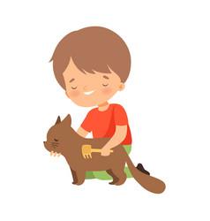 Little boy brushing his cat vector