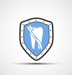 Shield with a human tooth and toothbrush vector