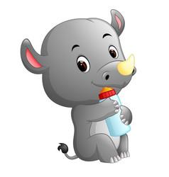 rhino holding baby bottle with nipple vector image