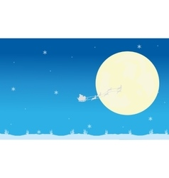 Silhouette of santa sleigh and full moon vector