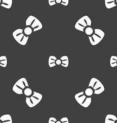 Bow tie icon sign Seamless pattern on a gray vector image