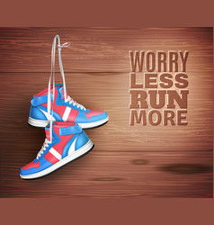 Pair of leather sports shoes on wood background vector