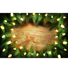 Christmas pine wreath with lights on wooden backgr vector image vector image
