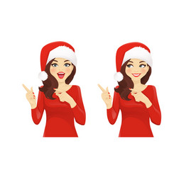 Surprised woman pointing in santa hat vector