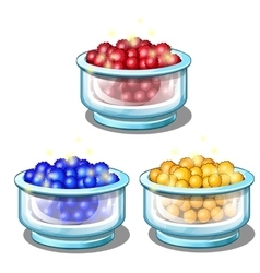 Red blue and yellow balls in glass cups vector