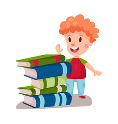Cute redhead boy standing next to a pile of books vector