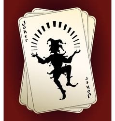Joker silhouette on playing cards vector