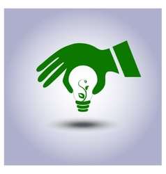 Green ecology light bulb icon in hand vector image