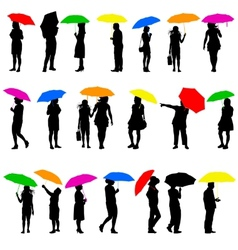 Set silhouettes of men and women with umbrellas vector image
