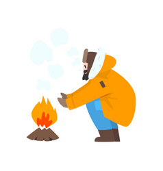 Warmly dressed man warming his hands by the fire vector