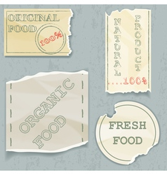 Labels of natural food on scraps of the old paper vector image