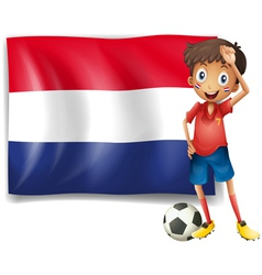The flag of Netherlands with a soccer player vector image vector image