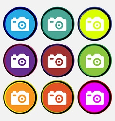 Photo Camera icon sign Nine multi-colored round vector image
