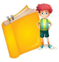 A young curly boy and a big book vector image vector image