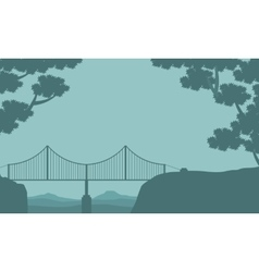 Silhouette of bridge and tree landscape vector image