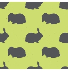 Seamless pattern with rabbit silhouettes vector image