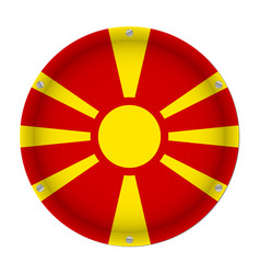 round metallic flag of macedonia with screws vector image