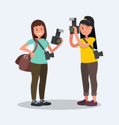 Two female photographer with cameras vector