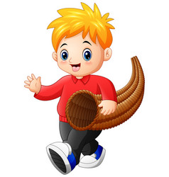 Little boy with horn of plenty vector