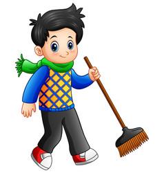 cartoon boy holding a broom vector image