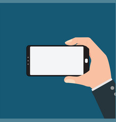 businessman holding smartphone isolated on blue vector image