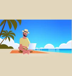 man using laptop on tropical sea beach summer vector image