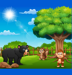 the animals are enjoying nature by the cage vector image