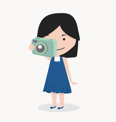 smiling little girl take a photograph vector image