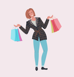 Woman fashion blogger holding colorful shopping vector